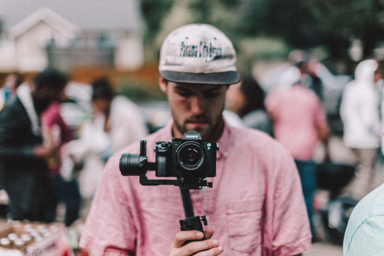 man, camera, fade
