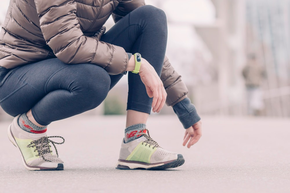 Person Wearing Gray-and-green Running Shoes