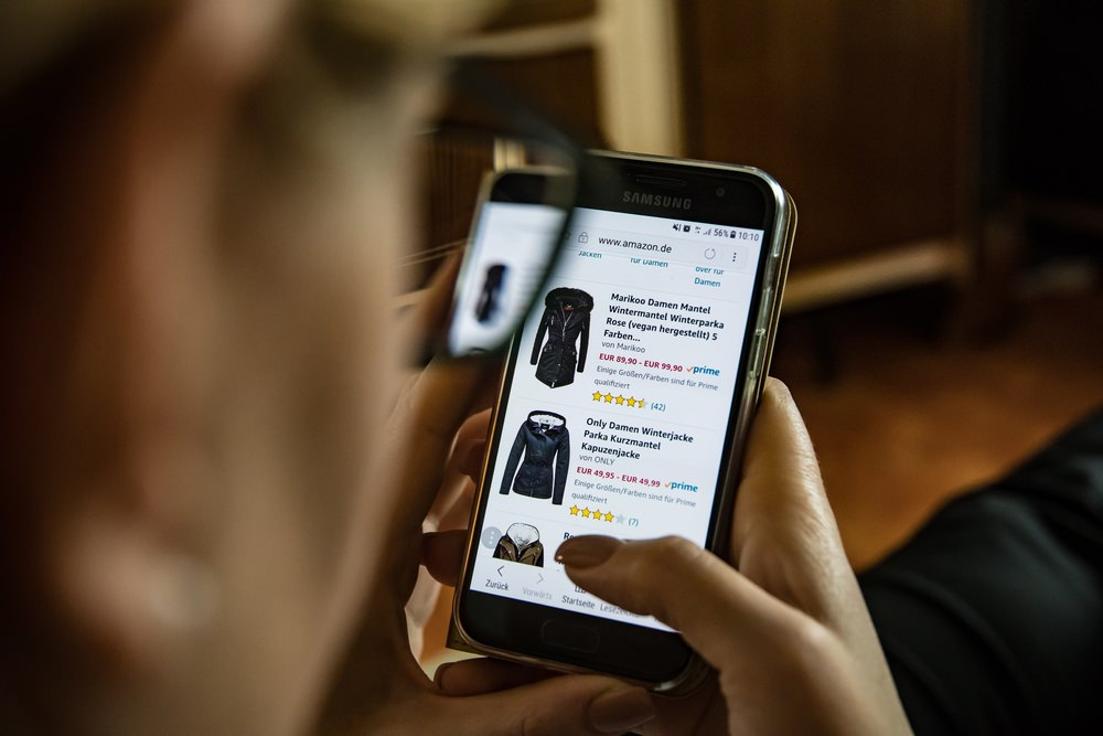 Person Shopping Online Using a Cellphone